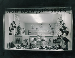 A Luers storefront display of shoes, purses and boots.